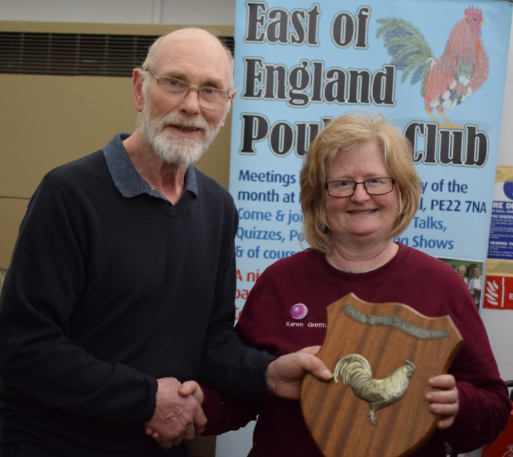 Karen Griffiths receiving the Champions's Shield from President Brian Sands